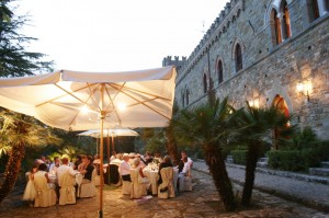 round tables outside wedding in italy castle borgia